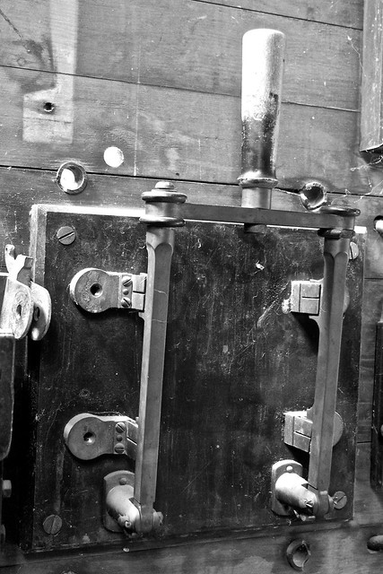Black and white image of a large knife switch
