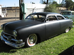 pontiac chieftain(0.0), plymouth cranbrook(0.0), automobile(1.0), automotive exterior(1.0), 1949 ford(1.0), vehicle(1.0), mid-size car(1.0), compact car(1.0), antique car(1.0), sedan(1.0), classic car(1.0), land vehicle(1.0),