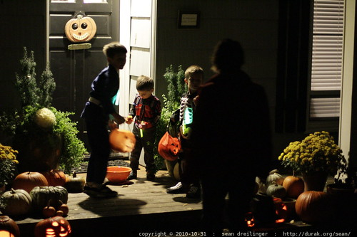 helping themselves to self serve candy on somebody's porch