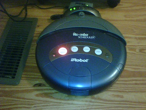 Roomba robotic vacuum cleaner with lights on. Photo: benfulton, cc on flickr