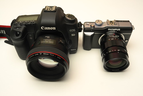 Canon 5DII + EF 50/1.2L and Olympus PEN E-PL1 + Voigtländer Nokton 25/0.95 mFT, size comparison