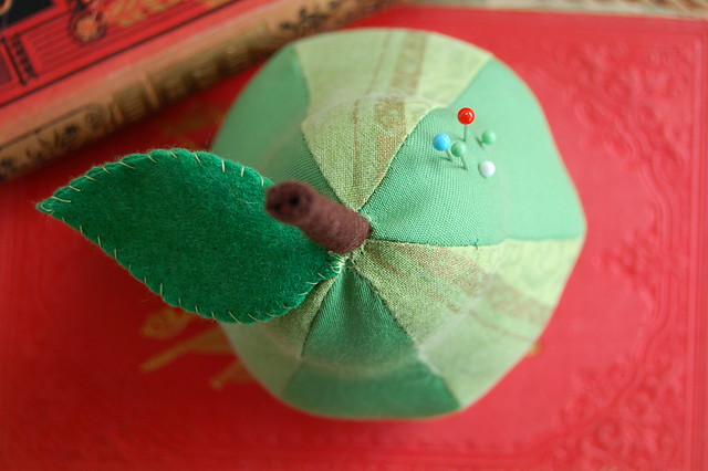 Sewn Needle holder Pear on vintage red book by iHanna, Copyright Hanna Andersson
