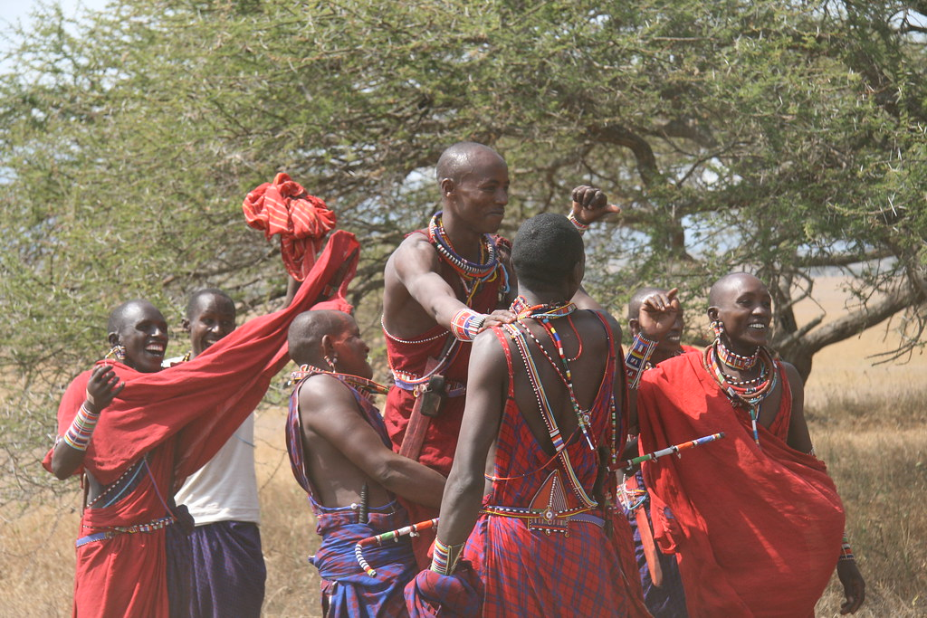 A group of Lion Guardians are shown celebrating the announcements of the Lion Guardian Game winners. Kapande Narok from Mbirikani Group Ranch, pictured here in the far left, was one of two Guardians that won the 'Most Improved Lion Guardian' award. Mokoi Lekanayia from Mbirikani Group Ranch, shown third from the left, received the award for 'Most Reliable Lion Guardian.'  Learn more about the joint Panthera/Living with Lions Lion Guardians program at www.panthera.org/programs/lion/lion-guardians  © Kylie McQualter