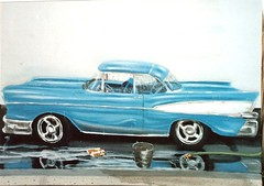 convertible(0.0), model car(1.0), automobile(1.0), automotive exterior(1.0), 1957 chevrolet(1.0), vehicle(1.0), full-size car(1.0), chevrolet bel air(1.0), sedan(1.0), land vehicle(1.0),