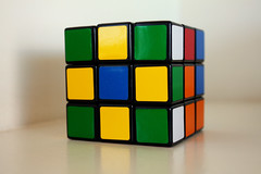 glass(0.0), puzzle(1.0), rubik's cube(1.0), yellow(1.0), mechanical puzzle(1.0), toy(1.0),