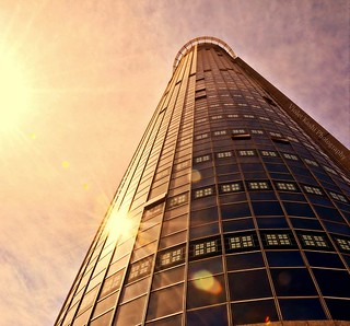 A skyscraper is a boast in glass and steel.