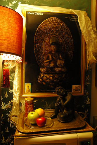 Buddha poster and sculpture with fruits, shrine on top of a microwave, Greenwood, Seattle, Washington, USA by Wonderlane