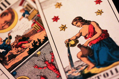 If you spill coffee on tarot cards, should you just replace them if some are quite damaged?