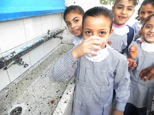 Girl Drinking Clean, Safe Water at Bureij Elementary School