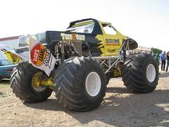 stock car racing(0.0), off road racing(0.0), sprint car racing(0.0), auto racing(1.0), automobile(1.0), racing(1.0), wheel(1.0), vehicle(1.0), sports(1.0), dirt track racing(1.0), motorsport(1.0), off-roading(1.0), monster truck(1.0),