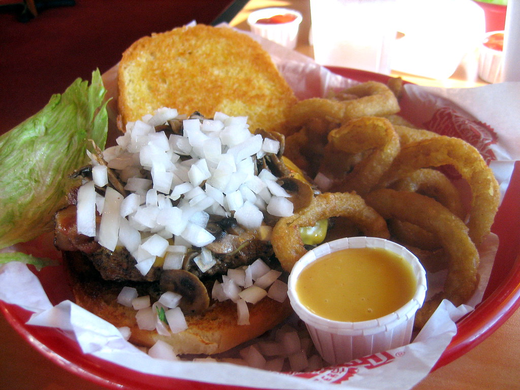 "1/2 lb ""the works"" hamburger with onion rings from fuddruckers"