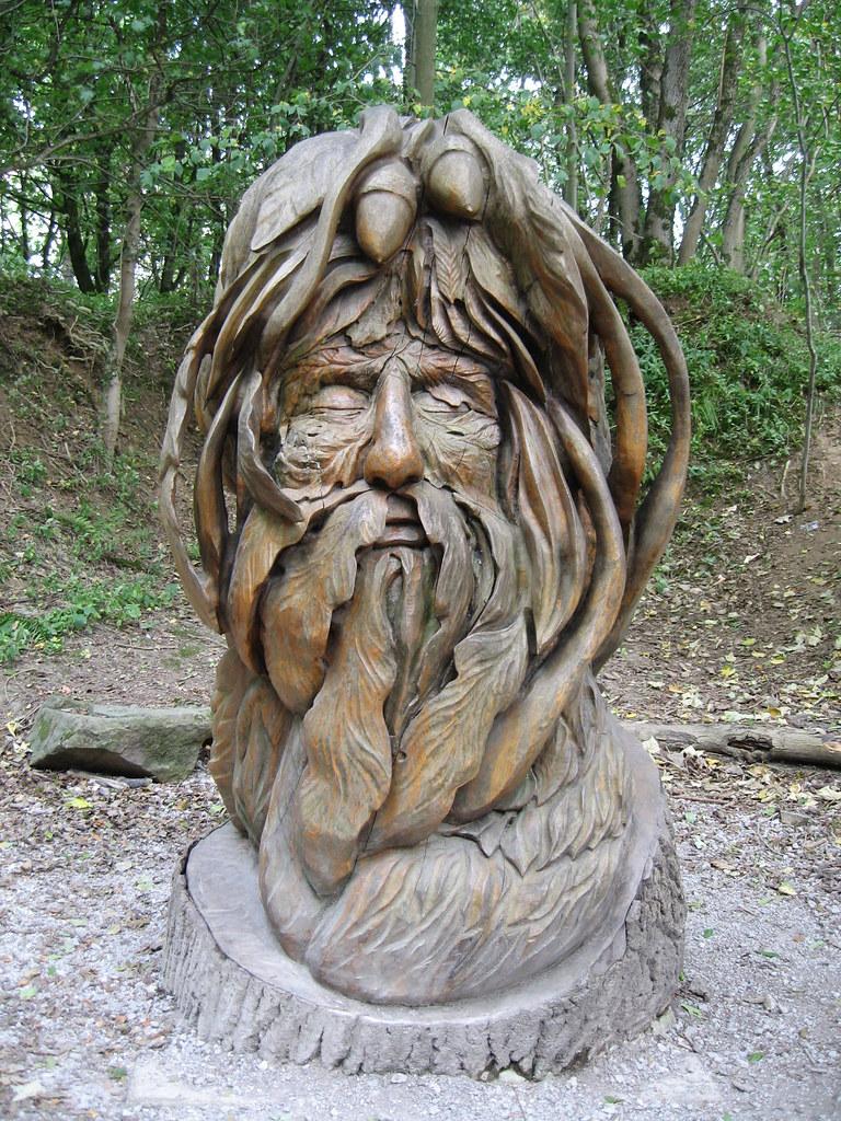 Knotty wood spirits carving a green eyed green man
