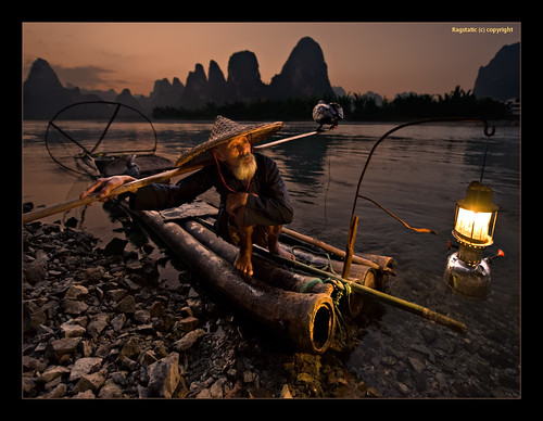 world life china old travel light sunset people fish man heritage feet nature relax still fishing hands nikon rocks exposure glow view time earth stones guilin rags yangshuo quality culture surreal scene bamboo shore balance cormorant raft lantern ng publication nationalgeographic subtle guangxi lifescape xingping singleexposure d700