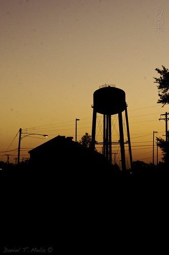 city morning sky urban building silhouette metal architecture publicspace contrast outdoor ominous military neworleans watertower navy commute