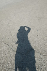 art(0.0), footprint(0.0), sand(0.0), pet(0.0), blue(0.0), asphalt(1.0), road surface(1.0), shadow(1.0),