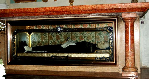 Waxwork of Blessed James of Ulm in a glass coffin.