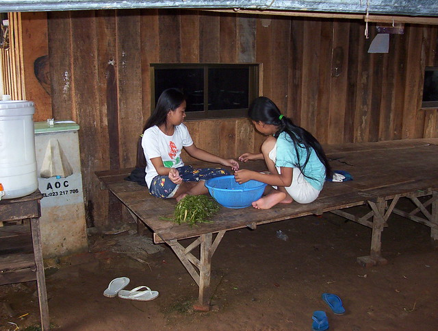 A Bed Just Outside The Kitchen Area In Cambodia They