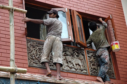 Second story painters, bamboo scaffolding, dragons and elephants decor, Boudha, Kathmandu, Nepal by Wonderlane