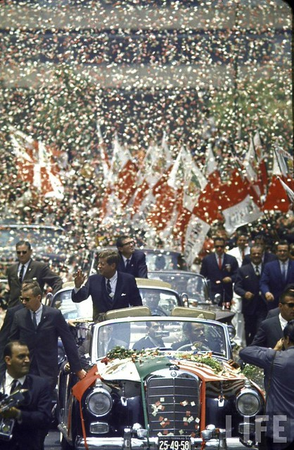 Motorcade for visiting US Pres. John F. Kennedy (L) and Mexican Pres. Adolfo Lopez (C sitting) is showered by confetti during state visit by Kennedy. 1962