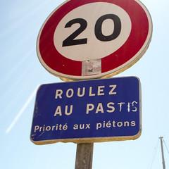 trademark(0.0), stop sign(0.0), vehicle registration plate(0.0), brand(0.0), signage(1.0), sign(1.0), number(1.0), street sign(1.0), font(1.0), traffic sign(1.0),