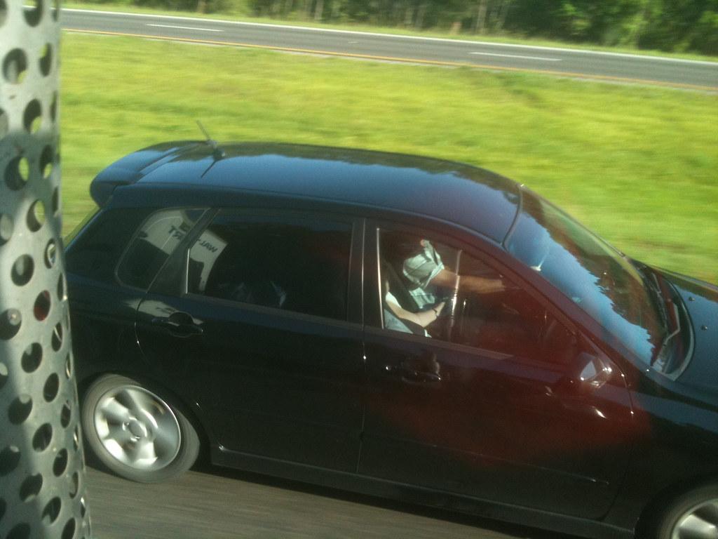 Guy Flashing In Car