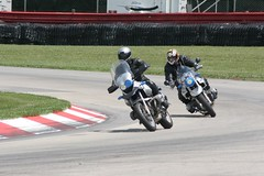 superbike racing(0.0), auto race(0.0), supermoto(0.0), stunt performer(0.0), motorcycle speedway(0.0), stunt(0.0), automobile(1.0), racing(1.0), vehicle(1.0), sports(1.0), race(1.0), motorcycle(1.0), motorsport(1.0), motorcycle racing(1.0), road racing(1.0), motorcycling(1.0), race track(1.0),
