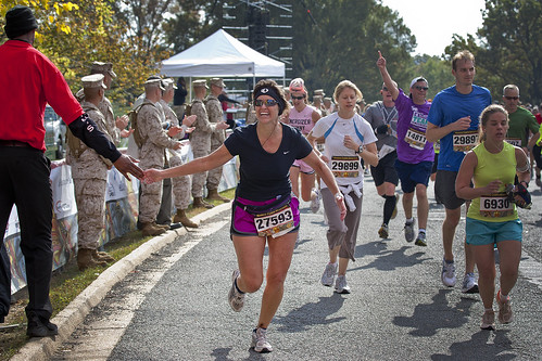 Runners cross the finish line of the 35th Marine Corps Marathon