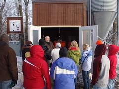 A tour group learns about the biomass boiler - click for larger image