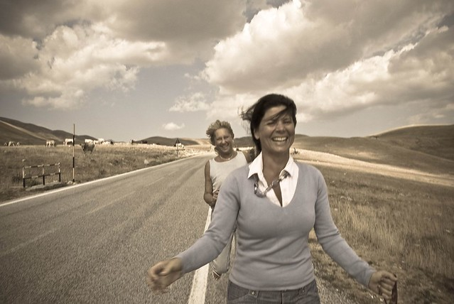 2 women running from mad cows at Campo Imperatore