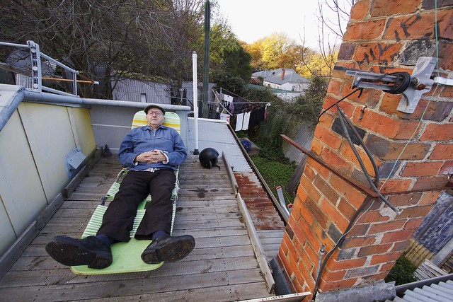 Man on roof top sundeck