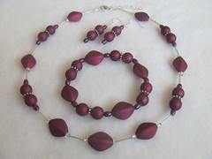 amethyst(0.0), gemstone(0.0), pink(0.0), petal(0.0), magenta(1.0), purple(1.0), violet(1.0), maroon(1.0), jewellery(1.0), circle(1.0), bracelet(1.0), necklace(1.0), bead(1.0),