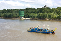 cargo ship(0.0), barge(0.0), raft(0.0), machine(1.0), ferry(1.0), vehicle(1.0), river(1.0), dredging(1.0), boating(1.0), channel(1.0), watercraft(1.0), boat(1.0), waterway(1.0),