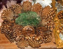 tree(0.0), christmas decoration(0.0), produce(0.0), food(0.0), dish(0.0), wreath(0.0), decor(1.0), conifer cone(1.0),