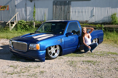1989 Chevy Silverado Photo Shoot blue truck on air ride with a girl next to it