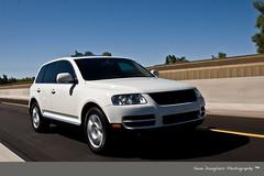 automobile(1.0), automotive exterior(1.0), sport utility vehicle(1.0), wheel(1.0), vehicle(1.0), compact sport utility vehicle(1.0), volkswagen touareg(1.0), bumper(1.0), land vehicle(1.0), luxury vehicle(1.0),