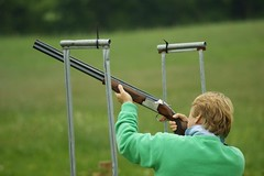 archery(0.0), target archery(0.0), bow and arrow(0.0), individual sports(1.0), clay pigeon shooting(1.0), sports(1.0), recreation(1.0), outdoor recreation(1.0), trap shooting(1.0), green(1.0), skeet shooting(1.0),