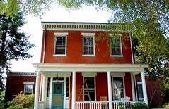farmhouse(0.0), siding(0.0), mansion(0.0), villa(0.0), window(1.0), building(1.0), property(1.0), porch(1.0), cottage(1.0), house(1.0), estate(1.0), residential area(1.0), facade(1.0), home(1.0), neighbourhood(1.0),