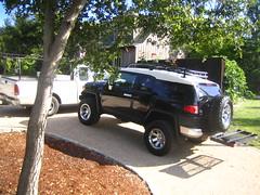 off-roading(0.0), automobile(1.0), automotive exterior(1.0), sport utility vehicle(1.0), wheel(1.0), vehicle(1.0), toyota fj cruiser(1.0), compact sport utility vehicle(1.0), bumper(1.0),