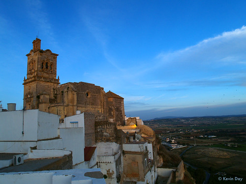 travel blue sunset shadow sky cliff white tower church birds horizontal clouds evening spain rooftops dusk horizon wideangle olympus andalucia patio spanish sanpedro swifts whitewashed arcos e500 arcosdelafrontera whitehilltown lacasagrande