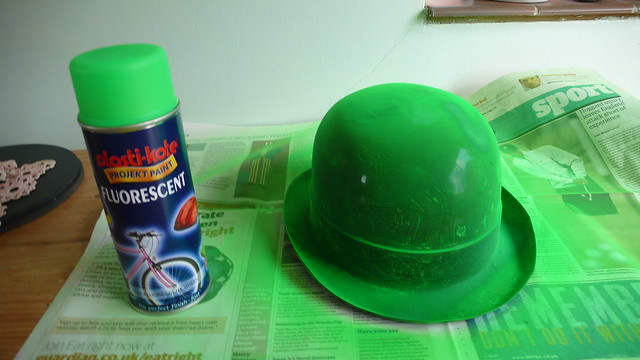 Spraying the bowler hat fluorescent green