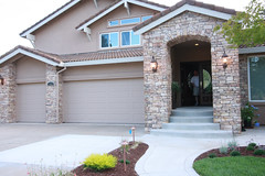 window, garage door, property, driveway, porch, yard, cottage, estate, residential area, door, real estate, facade, home, walkway,