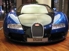 wheel(0.0), automobile(1.0), bugatti(1.0), automotive exterior(1.0), vehicle(1.0), automotive design(1.0), auto show(1.0), bugatti veyron(1.0), land vehicle(1.0), luxury vehicle(1.0), supercar(1.0), sports car(1.0),