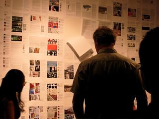 People reading blog posts at the Postopolis! closing party