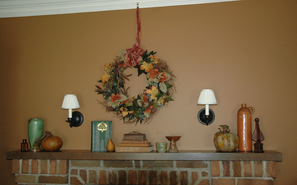 Fireplace mantel decorated for fall.