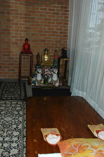Buddhas, shrine, prostration board, front porch of apartment, Greenwood neighborhood, Seattle, Washington, USA by Wonderlane