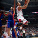 D. Rose goes up and under the rim