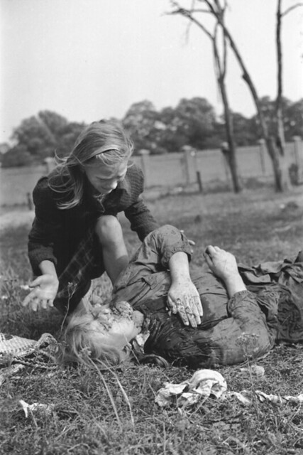 Kazimiera Mika, age 10, mourns her sister killed by German bombs