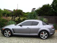 automobile(1.0), automotive exterior(1.0), wheel(1.0), vehicle(1.0), automotive design(1.0), rim(1.0), bumper(1.0), land vehicle(1.0), luxury vehicle(1.0), mazda rx-8(1.0), supercar(1.0), sports car(1.0),