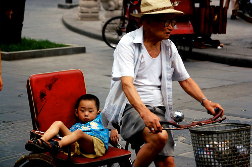 Old man carrying his grandchild (Chengdu, China)
