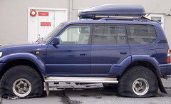 off-roading(0.0), toyota land cruiser(0.0), automobile(1.0), automotive exterior(1.0), sport utility vehicle(1.0), wheel(1.0), vehicle(1.0), mitsubishi challenger(1.0), compact sport utility vehicle(1.0), toyota land cruiser prado(1.0), bumper(1.0), land vehicle(1.0),